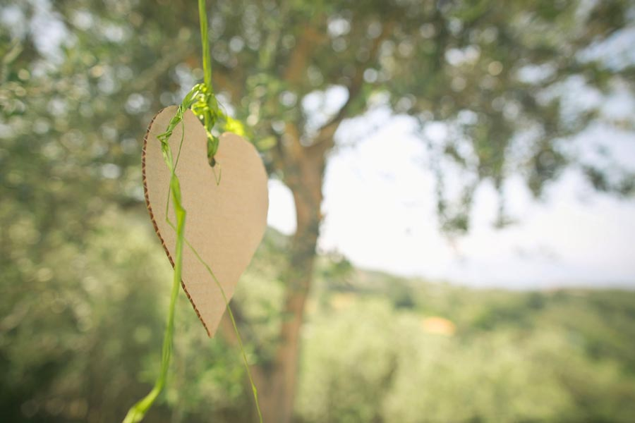 Heart details hanging from tree