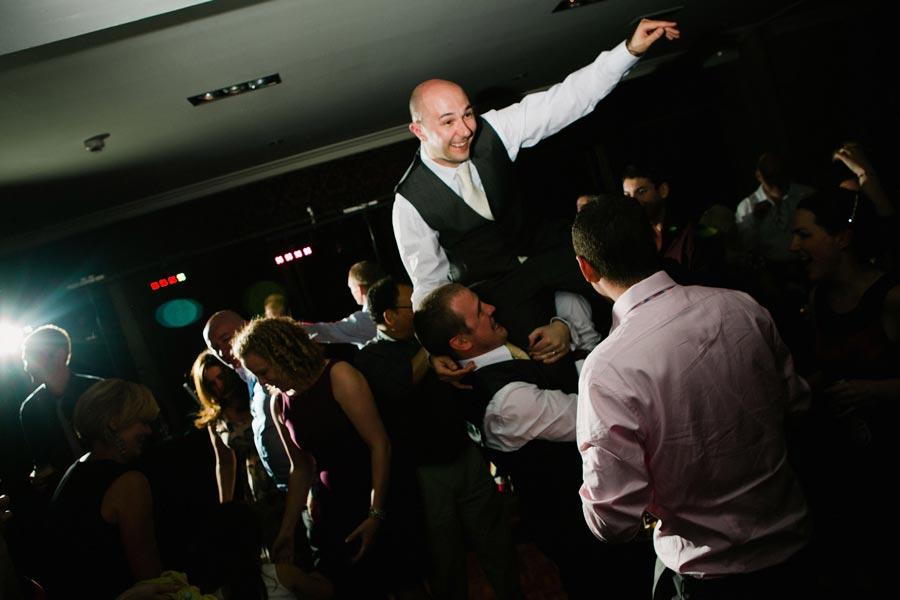 groom gets picked up on the dancefloor