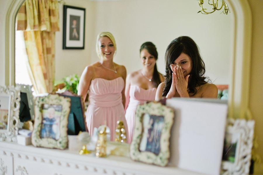 bride and bridesmaids crying