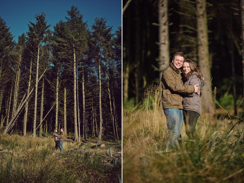 Wedding couple having a hug in front of pine trees,