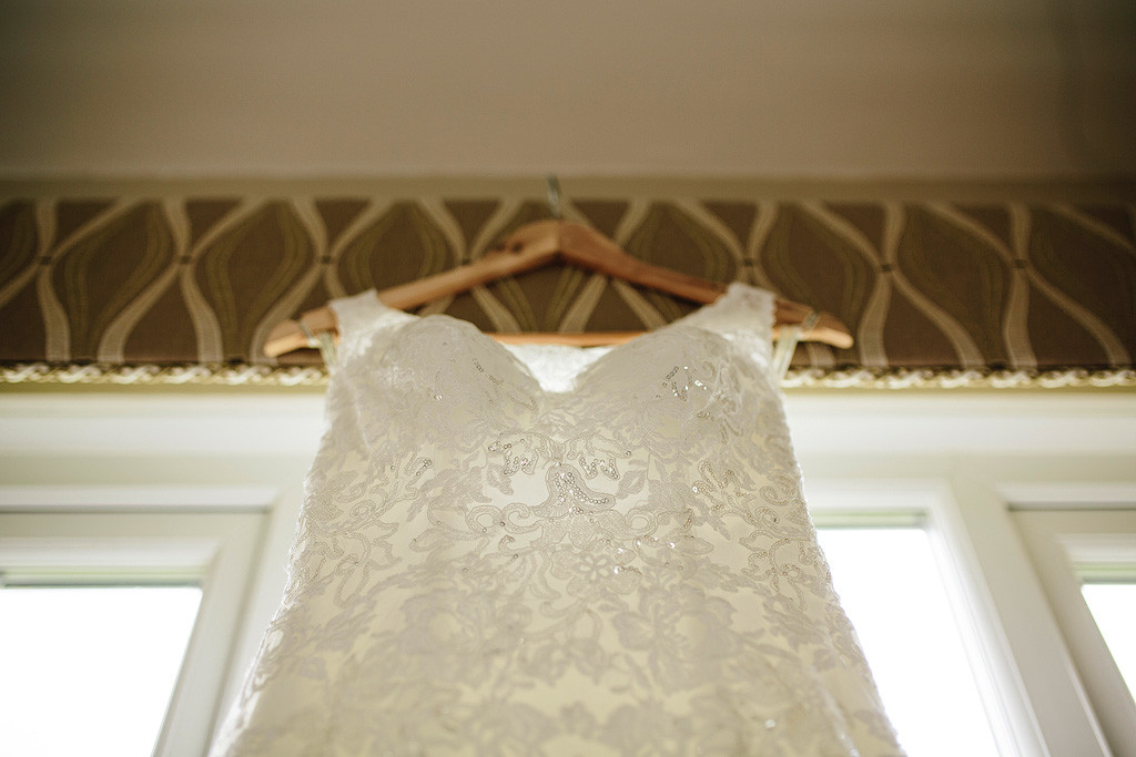 the bride's wedding dress hanging up