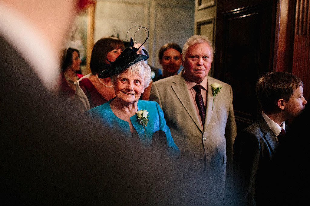 the groom's grandmother arrives for the ceremony
