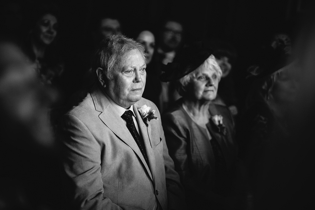 a black and white photo of the bride's grandfather