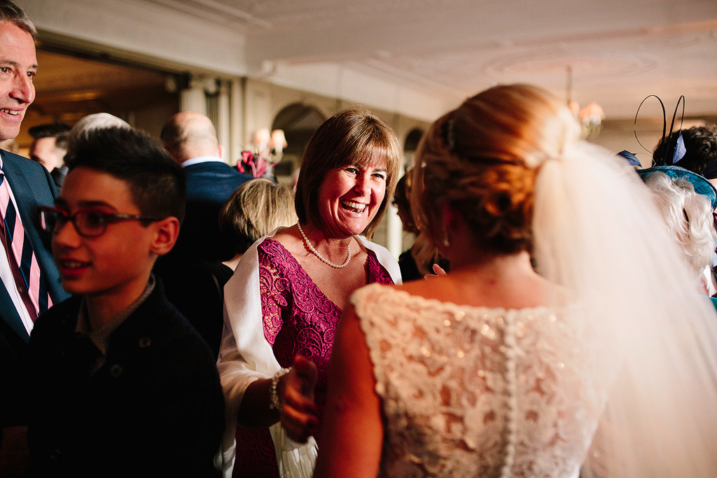 a happy guest talks to the bride
