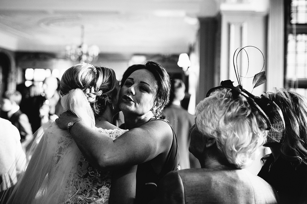 a guest hugs the bride