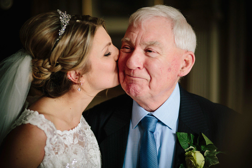 the bride kisses her grandad