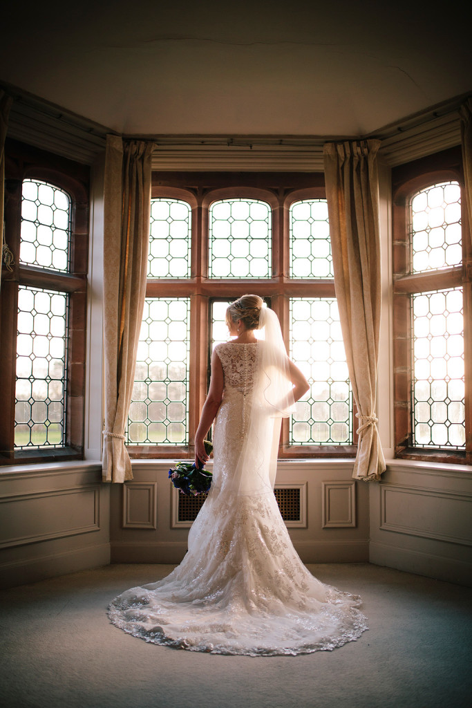 a stunning shot of the bride in the honeymoon suite