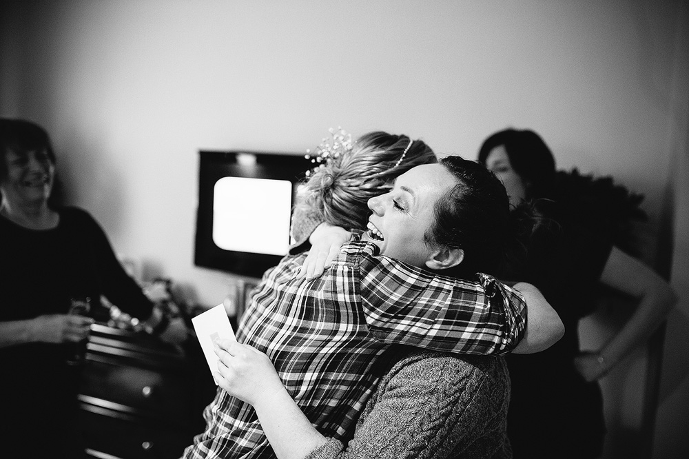 the bride hugging her bridesmaid