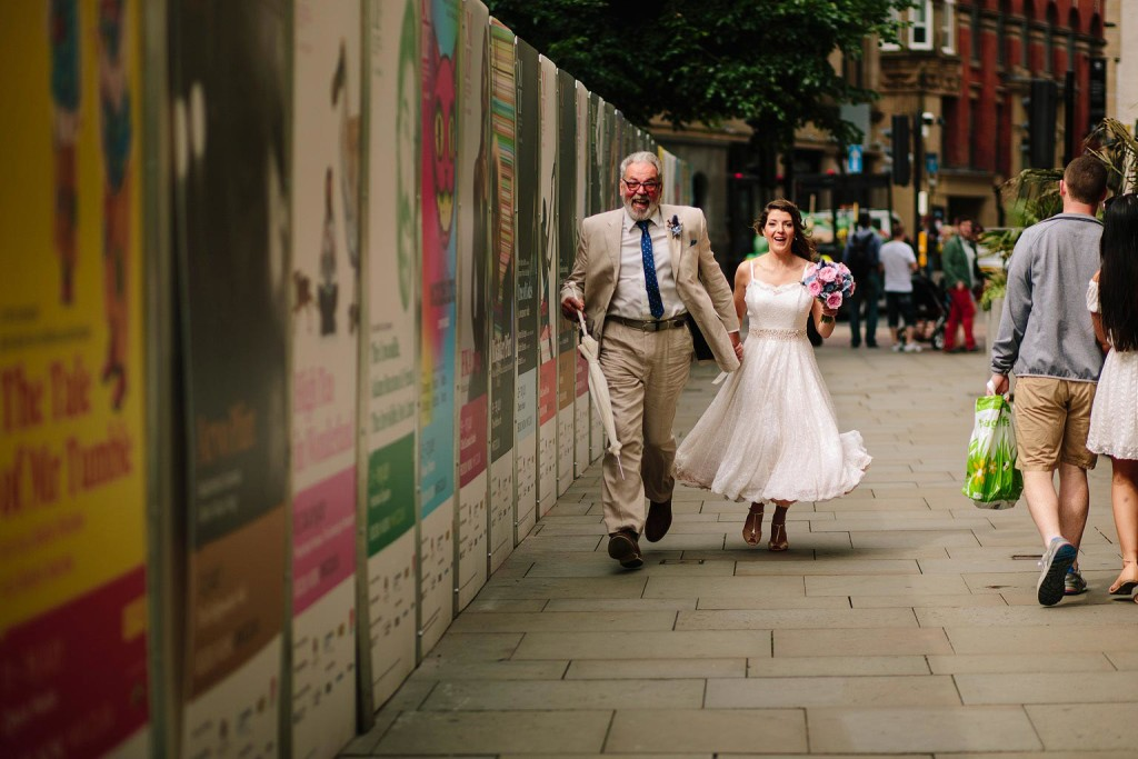 the bride and her dad run to the ceremony because they are late