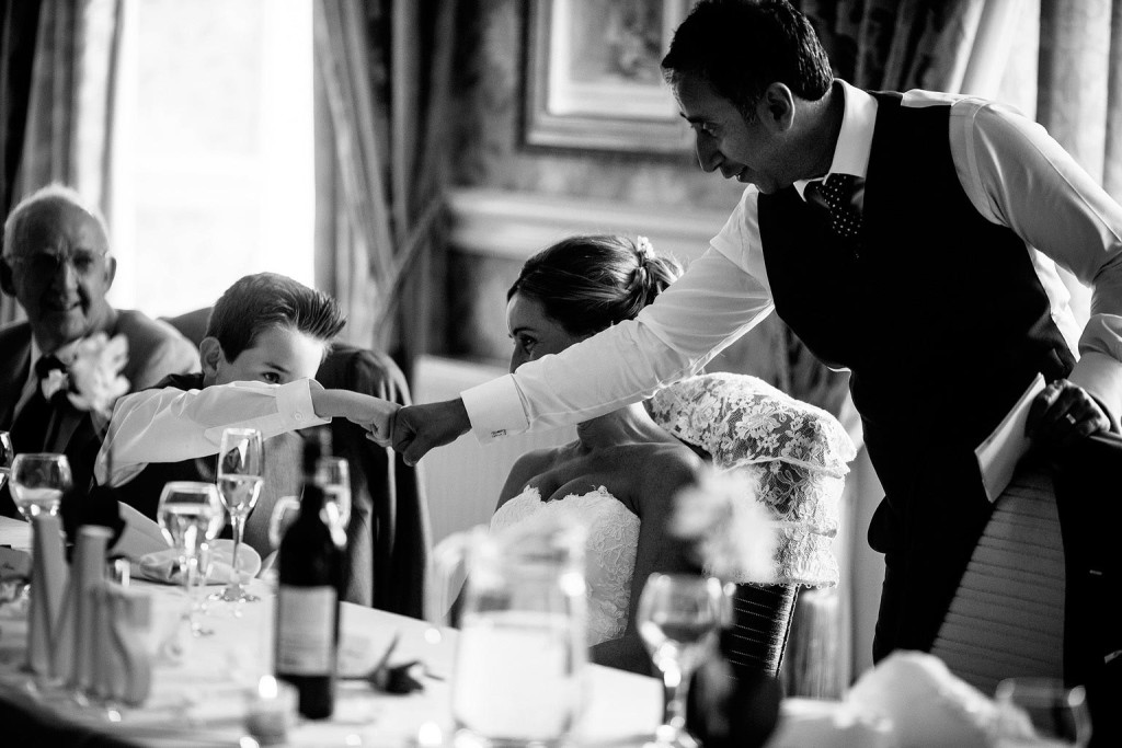 the groom fist bumps his step son
