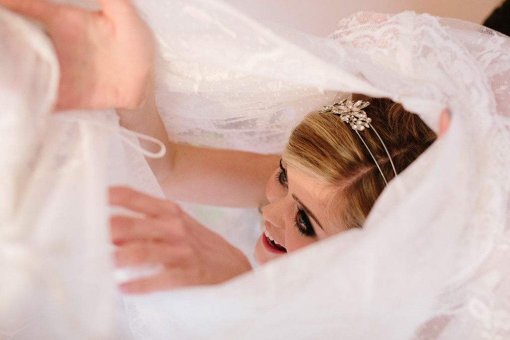 the bride finds her way up inside her dress