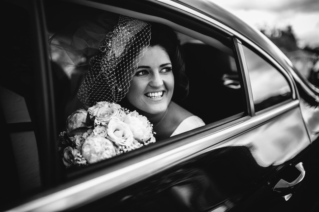 grace looks out of the window of the wedding car