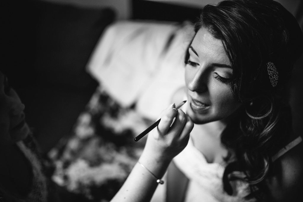 the bride has her make up applied