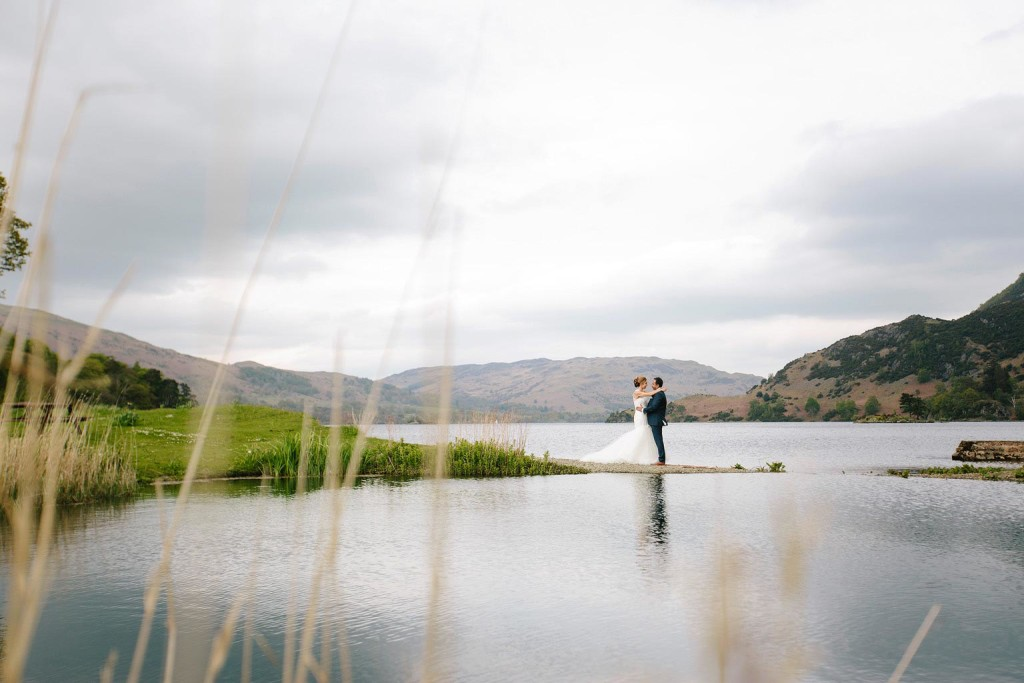a portrait of the couple on the banks of Lake Windermere