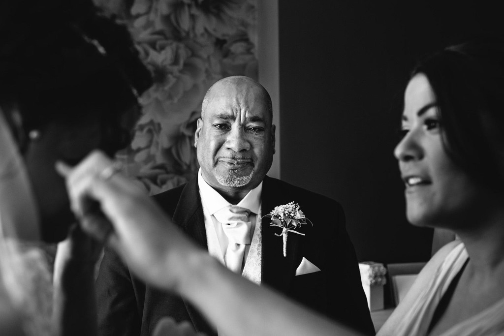 father of the bride crying as he sees his daughter ready for the wedding