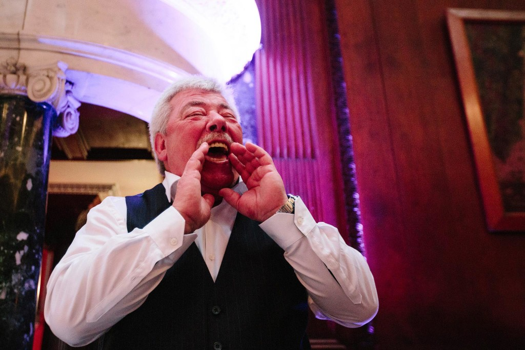 fantastic shot of the dad shouting to the wedding guests