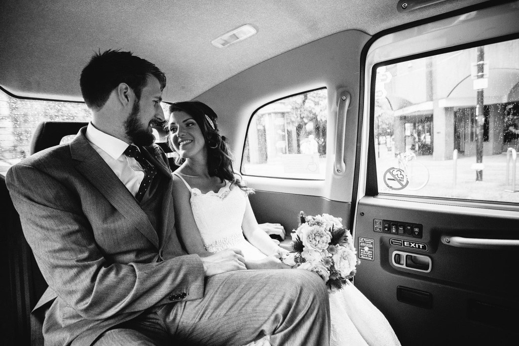 in the back of a taxi with the best couple