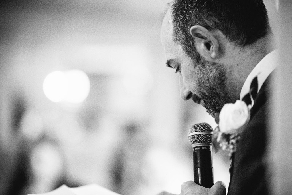 a clode up photo of the groom during the speeches