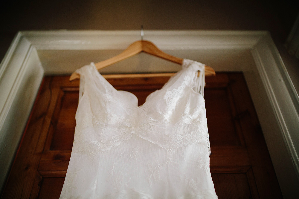 the wedding dress hangs on the wardrobe