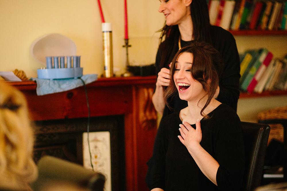 a bridesmaid laughs heartily