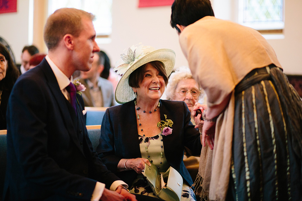 kate's mum looks excited before the start of the wedding ceremony