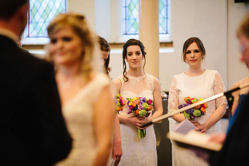 the bridesmaids watch the matrimonial ceremony