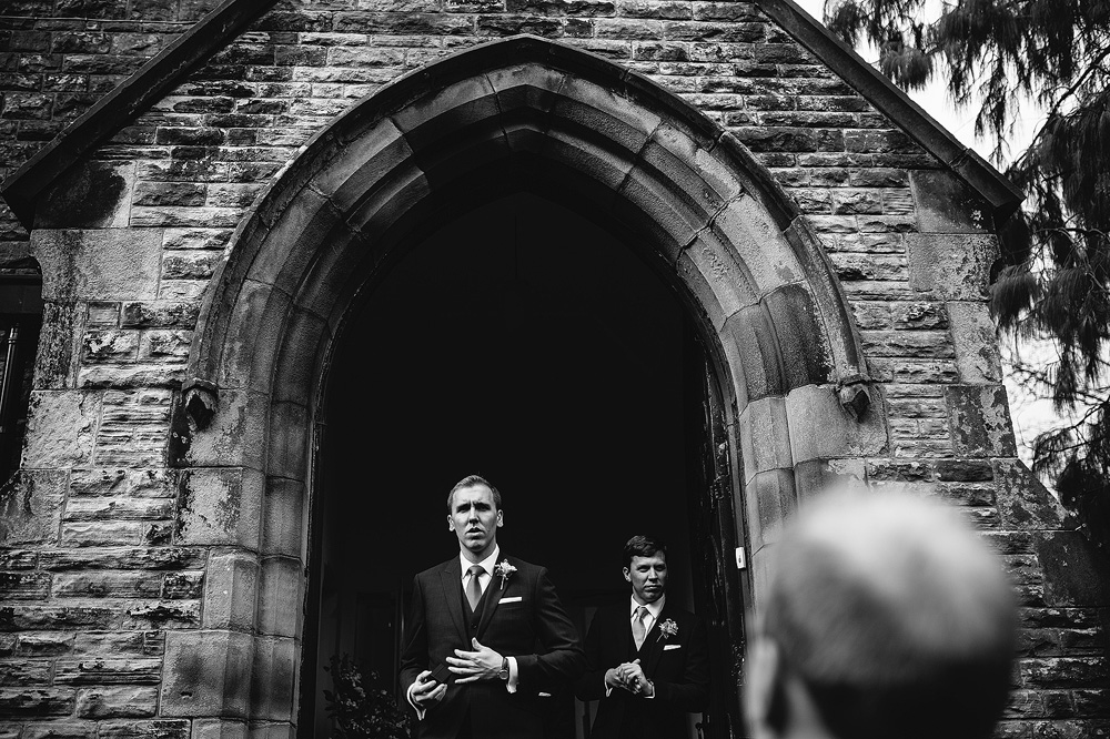 a black and white shot of the groomsmen