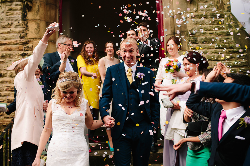 confetti is thrown at the couple after there sacrament of matrimony