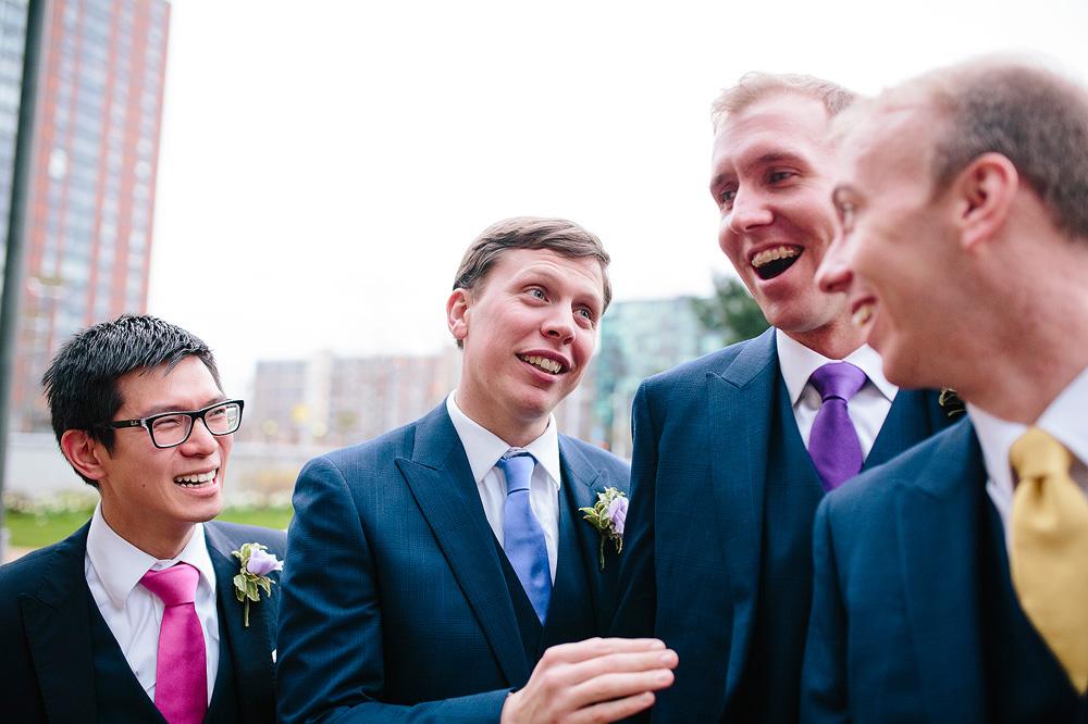 one of the groomsmen talks to the groom
