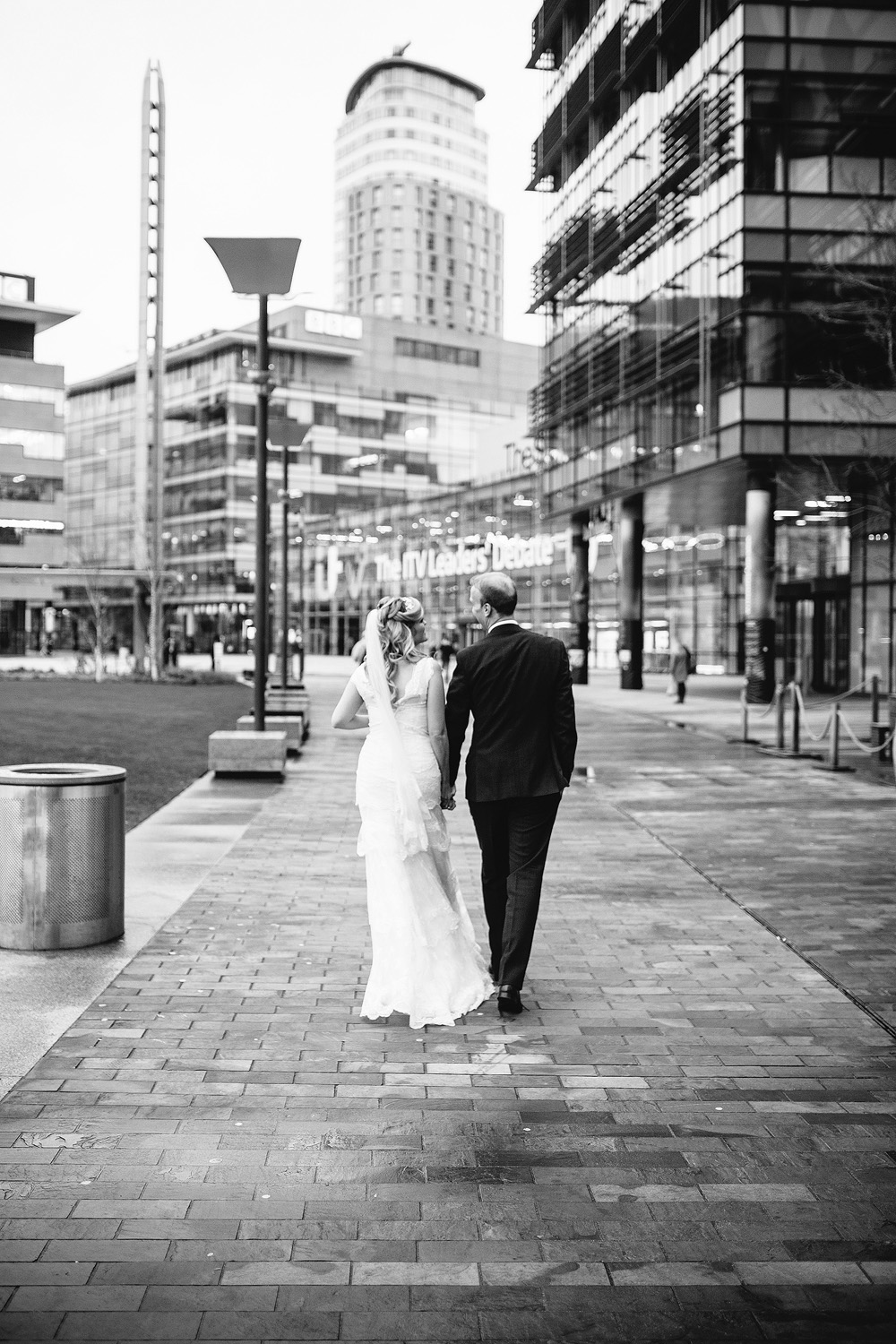 a black and white shot of the couple walking