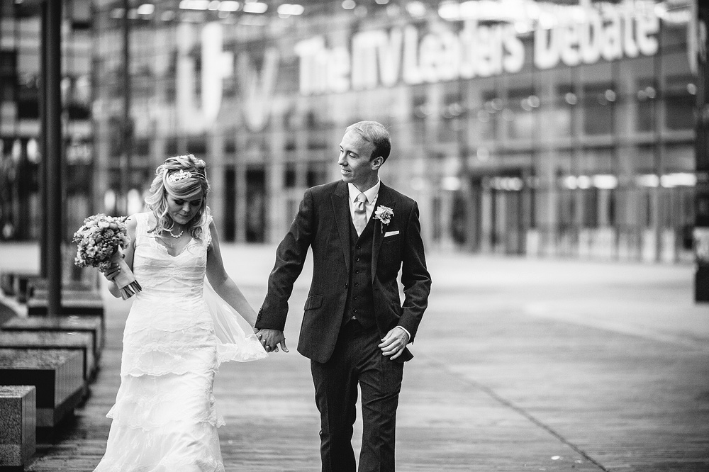 a natural relaxed portrait of the couple walking through media city