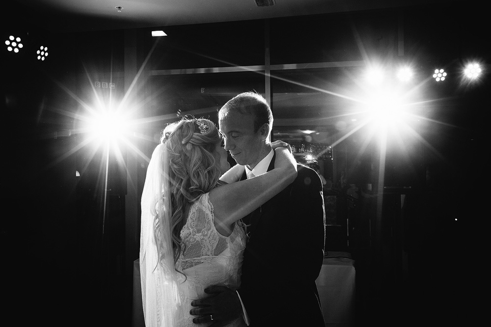 the bride and groom enjoy their first dance as a married couple
