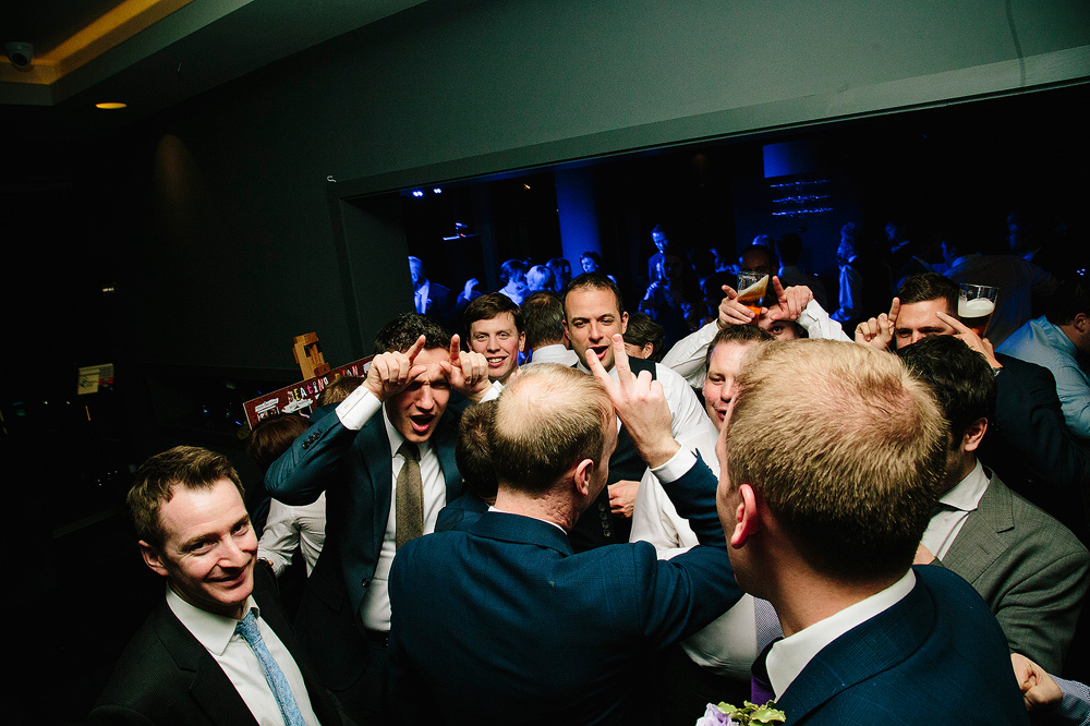 the groomsmen do an impression of a stag