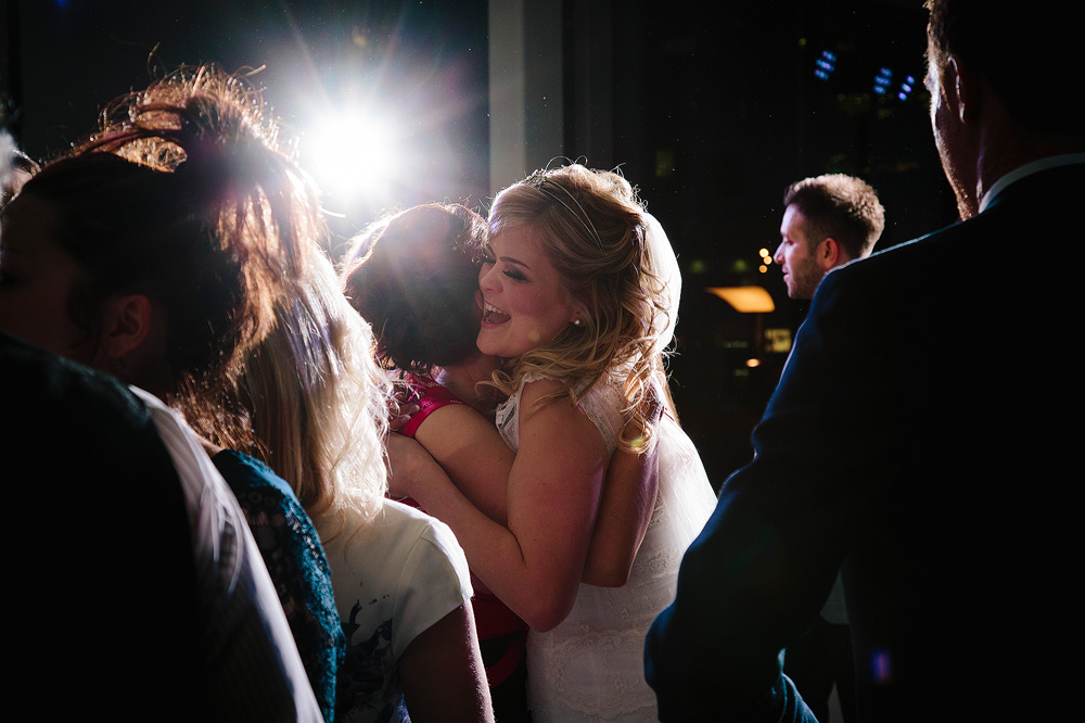 the bride hugs her friend