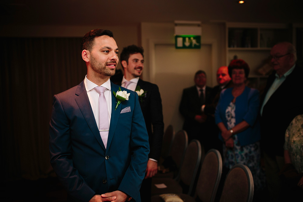 matt looks down the aisle as shelley enters the room