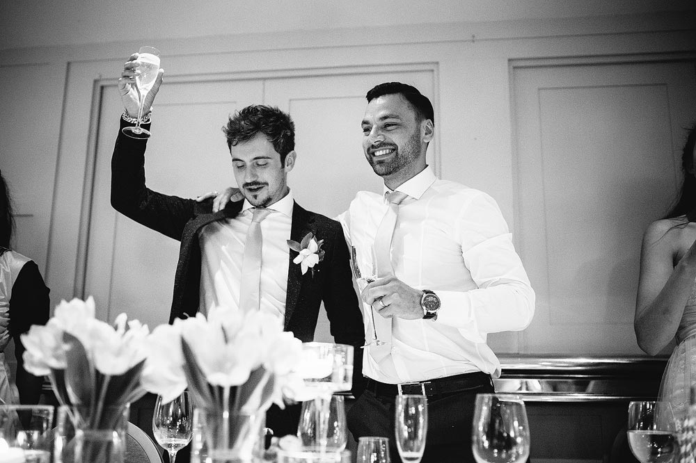The best man toasts the happy couple.