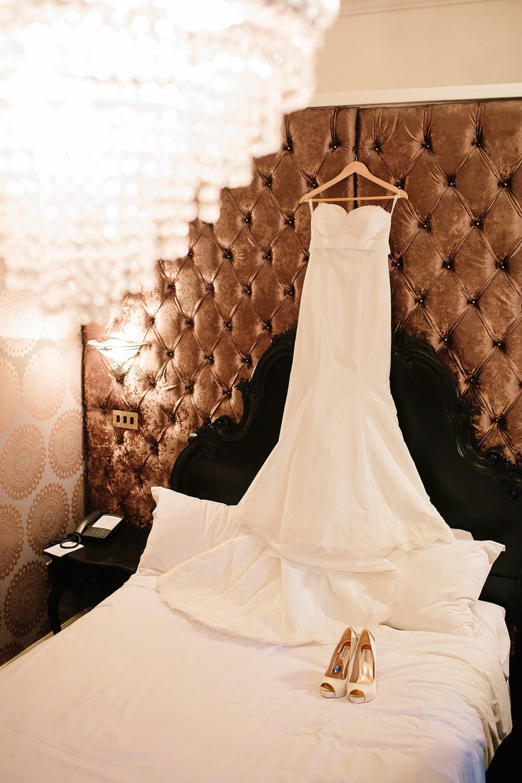 The wedding dress hanging up.