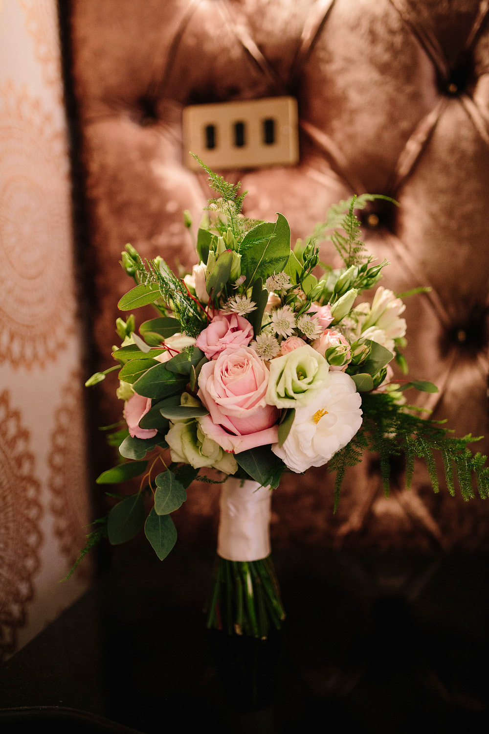 The bridal bouquet looks beautiful with all different flowers.