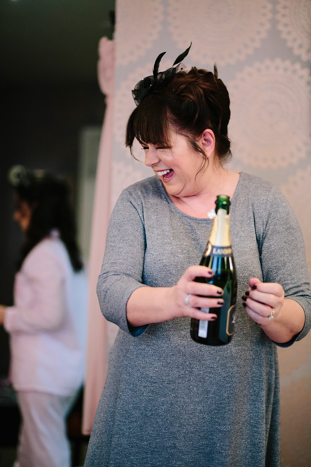 A bottle of champagne is opened
