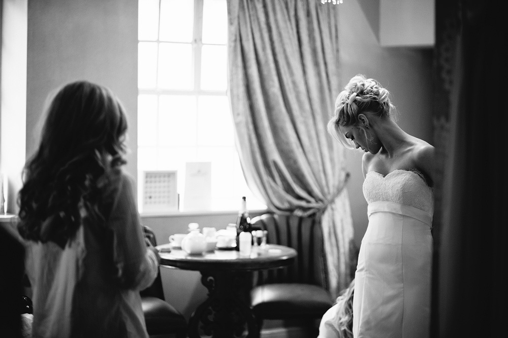 A stunning photo of the bride looking down at her dress.
