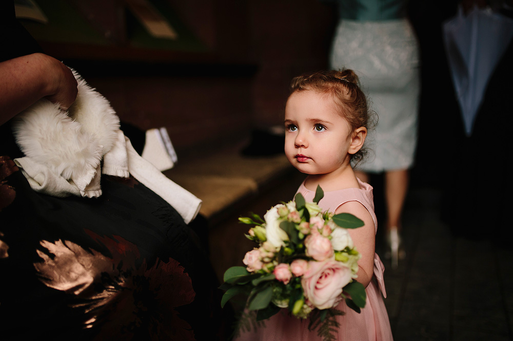 The flower girl with her flowers looks super.