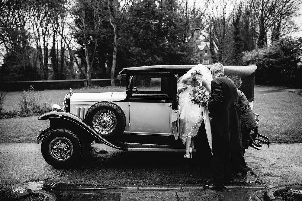 Adele gets out of the vintage wedding car.