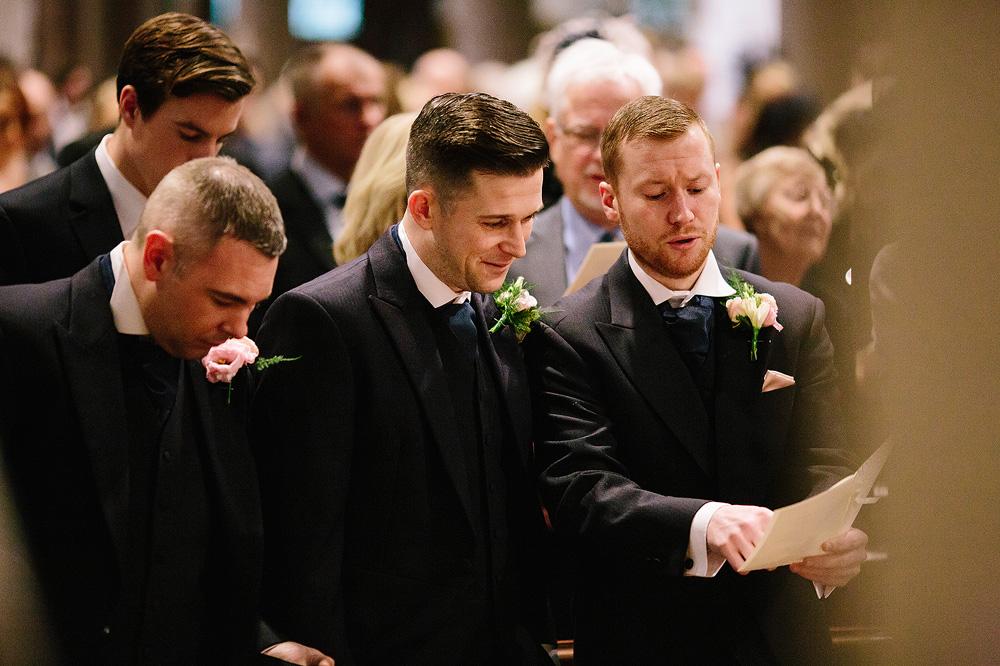 The groomsmen sing a church hymn.
