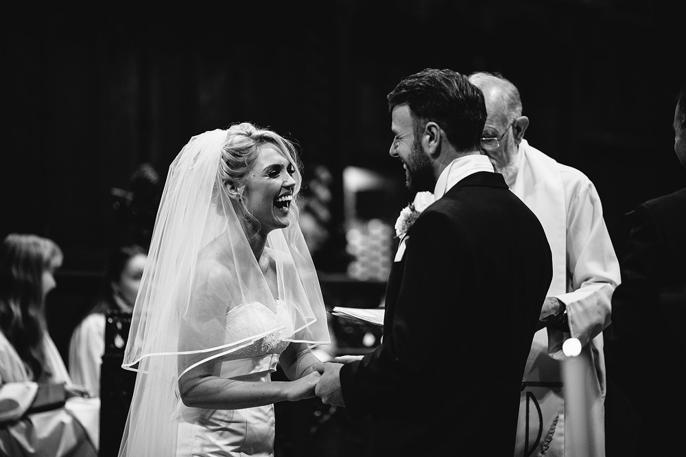 The bride and groom laugh together.