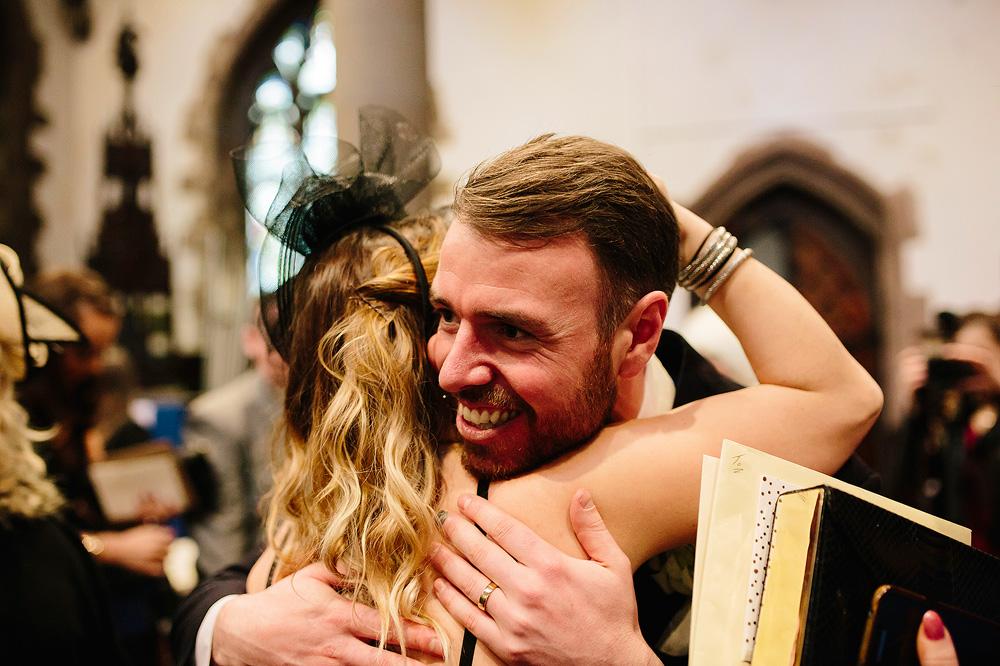 A guest hugs Ian to congratulate him.