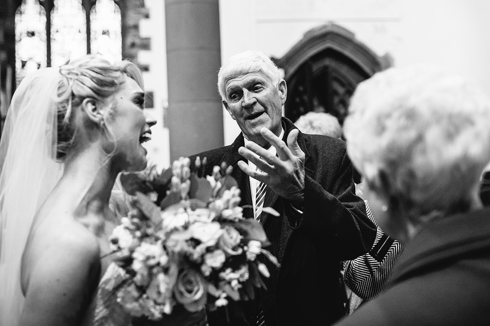 An old relative shares his thoughts with the bride.