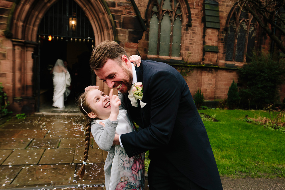 The groom tussles with his niece.