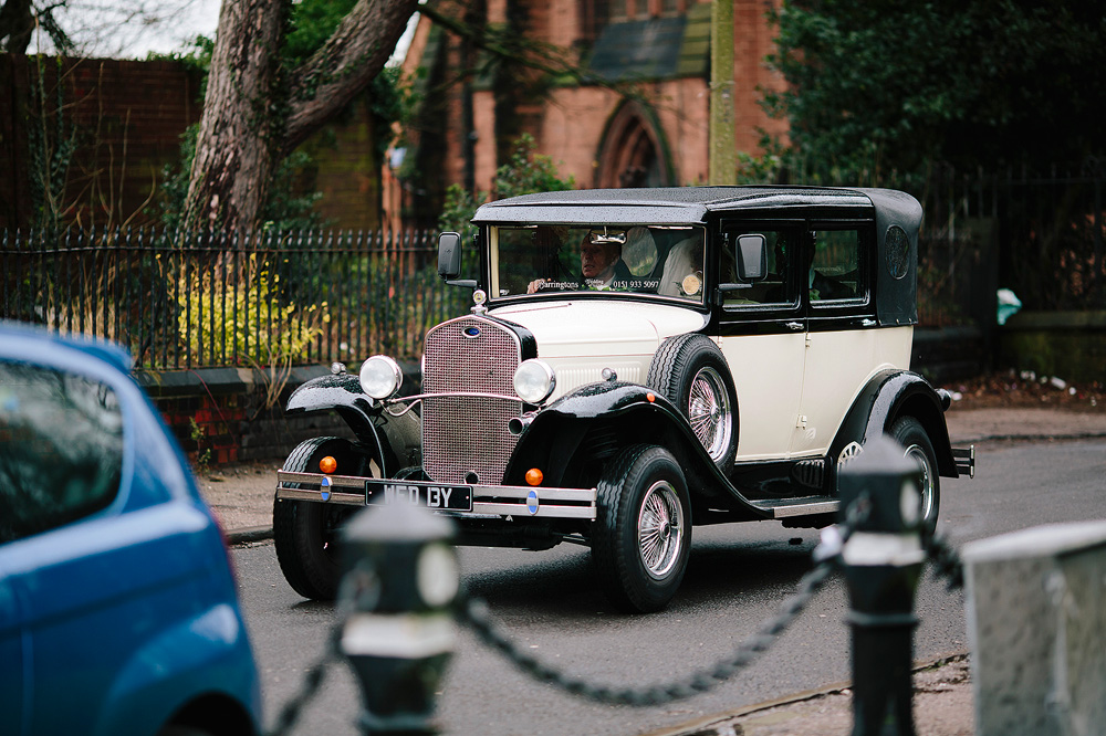 The vintage wedding car takes the bride and groom to the wedding reception at 30 James Street.
