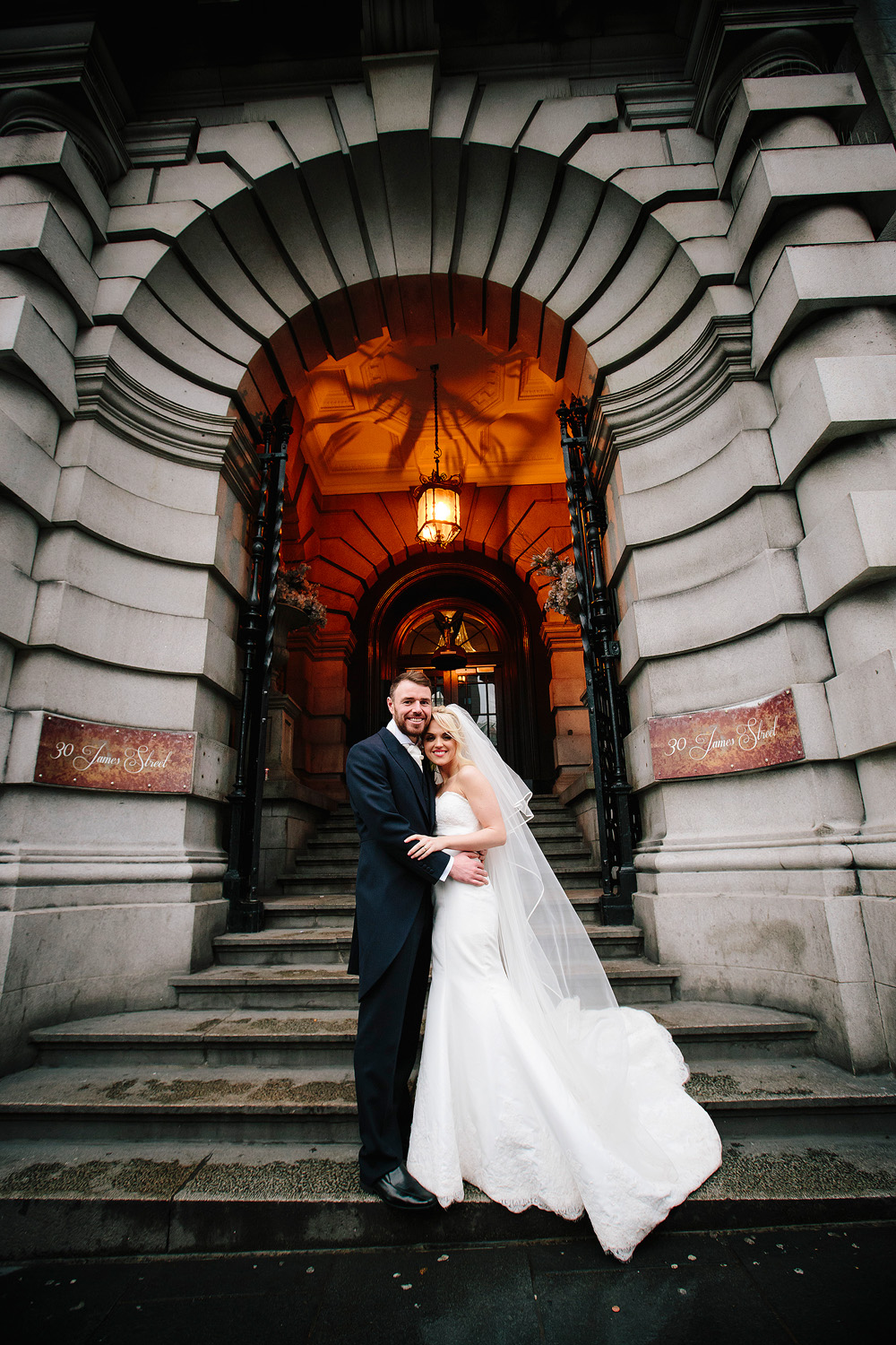 The bride and groom outside the entrance to 30 James Street.