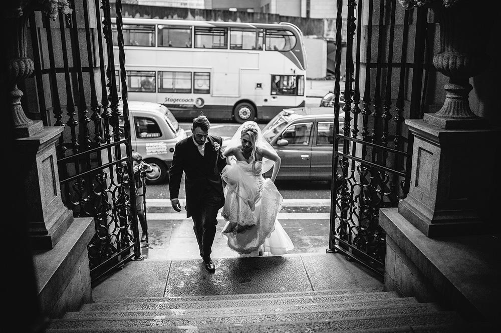 The couple walk back into 30 James street.